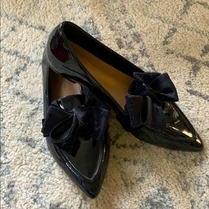 Black loafers with bow